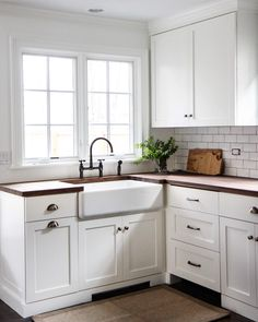 KITCHEN: Butcher block counters, white subway tile, farmhouse sink, hardware