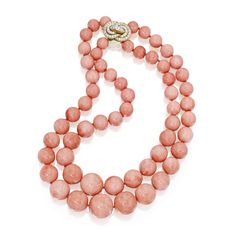 18 Karat Gold, Coral Bead and Diamond Necklace The double-strand necklace composed of 58 graduated coral beads, the clasp designed as a knot set with round diamonds weighing approx 1.20 carats.