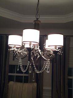 Chandelier upgrade using crystals and pearl garland. Purchased the garland at Michaels. Big improvement. No need to buy a new chandelier.