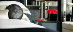 The red roses are a welcome and changeable use of colour #interiordesign