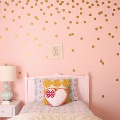 $22 Wall Decals You need to break up the white space, but paint is permanent and wallpaper is so passé. In glamorous gold vinyl, the Polka Dots Wall Decal has a hint of 1970s flair. They can be arranged and removed at will, so even commitment-phobes can get in on the fun.