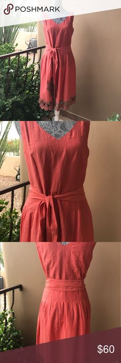 Coral dress 70% cotton 30% silk, feels like a handkerchief! This dress is very well made, tailored , intricate design. I paid $220, and have loved having it in my closet. Time for someone else to enjoy it! Nie & Zoe Dresses