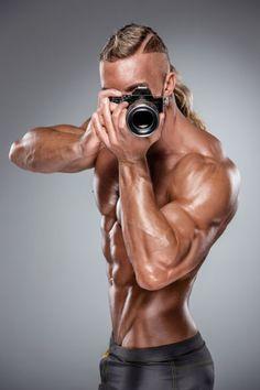 Attractive male body builder on white background by Volodymyr Melnyk