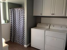 Our new half bath/laundry room. Sherwin Williams GRIS. Blue shower curtain from Wayfair