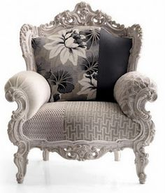 antique chair done in six coordinating fabrics