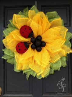 Here's our new 2016 version of the Sunflower wreath, we added ladybugs and more leaf petals to this wreath. It's an easy wreath to make. It's made out of paper mesh, and paper mesh is …made of paper. This paper mesh does have a special coating sprayed on it, but it's still paper. It should …