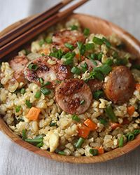 This fried rice is laced with lots of smoky flavor, thanks to golden brown rounds of kielbasa.-try this with cauliflower rice************************** Rice Recipes, Great Recipes, Cooking Recipes, Favorite Recipes, Healthy Recipes, Sausage Recipes, Asian Recipes, Recipies, Risotto Recipes