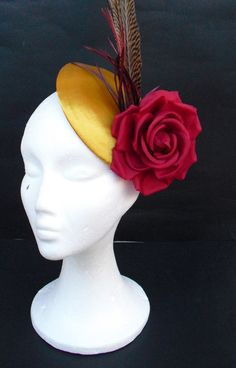 Pheasant feather fascinator /  red and gold  fascinator / Derby hat / Kentucky Derby / Wedding fascinator / Cocktail fascinator. $100.00, via Etsy.