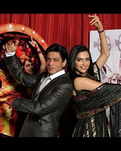 Om and Shanti strike a pose. SRK and Deepika mirror the actions from one of their posters of Om Shanti Om. Om Shanti Om was not only their first movie together but also the debut film for the talented Deepika Padukone.