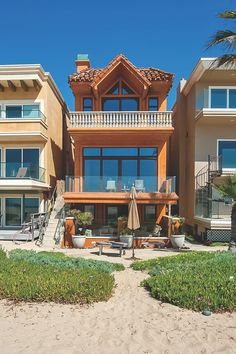 This Mediterranean-meets-contemporary home squeezes three levels of luxurious oceanfront living on a narrow lot.