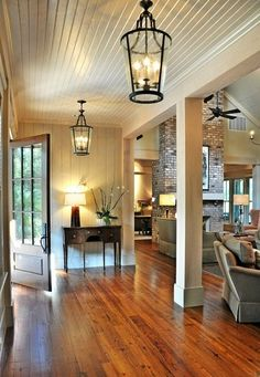 open floorplan, love the lights & the floors And the fireplace brick. I love this.