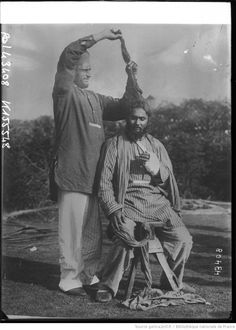 WWI; An injured Sikh soldier recovering in a New Forest hospital has his long hair combed and tied by a fellow patient. -Amandeep Madra (@amanmadra)   Twitter