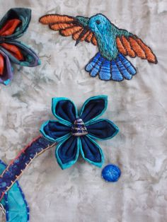 Detail of quilt from my Etsy shop with hummingbird and Kanzashi flowers. #kanzashi #quilt #hummingbird #embroidery