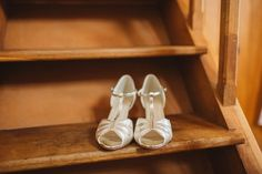 Silver and white satin peep toe, t-bar sandals. Photography by Frances Sales