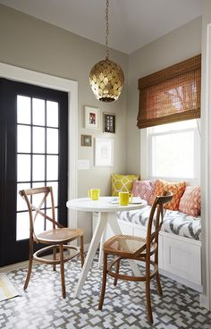 Black door, tile, chairs, light fixture, the bench with fun pillows - love everything about this pic!