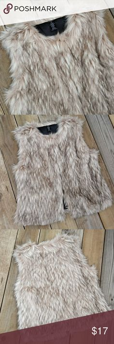 Fur Vest Super cute! Get noticed in this fun FAUX fur vest. Eyelet closures. No pockets. Fur in great condition, no piling or knotting. Beautiful cream with black on the ends of fur. Fur is 87% acrylic, 13% polyester. Lining 100% polyester. Mixit Jackets & Coats Vests