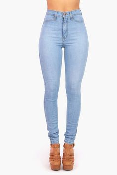 High waisted soft and stretchy skinny jeans in a light wash. Faux pockets at the front and open pockets at the back. Zip fly and button closure. *Machine Wash Cold *73% Cotton 14% Rayon 11% Polyester