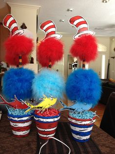 made these Dr.Seuss center pieces for my Baby shower... After the shower I used them as decor in the babies room~ I love these for centerpieces!!! ~ pots you can get at craft store~ with copon, rafia dollar store, printable hat~ or cardstock, I love these