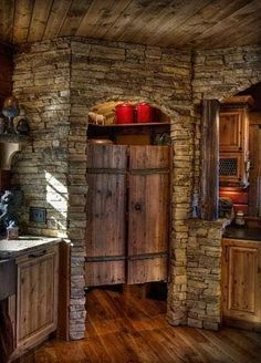 Love this rustic cabin kitchen! Look at that pantry!