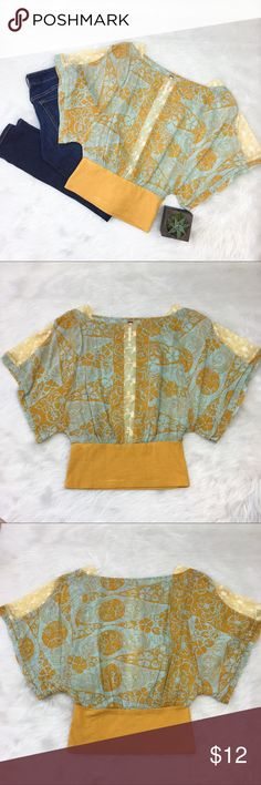 Free People Yellow & Blue Top Free People yellow & blue top. Size 2. Has beautiful lace details on front and sleeves. Lace is sheer! GUC with deodorant marks on bottom. It's been washed and they did not come out. When worn not extremely noticeable but have priced to reflect. ❌No trades ❌ Modeling ❌No PayPal or off Posh transactions ❤️ I 💕Bundles ❤️Reasonable Offers PLEASE ❤️ Bundle & SAVE❗️❗️ Free People Tops Blouses
