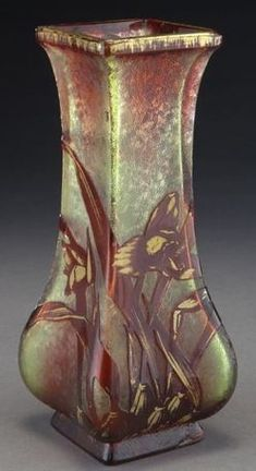 A Daum Nancy textured cameo glass vase, red ground decorated with gilt daffodils. Signed Daum, Nancy with the Cross of Lorraine. Made in France, circa 1801-1925