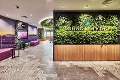 A purposefully-crafted retail space that combines design, personalisation, and functionality Window Signage, Retail Space, Green Walls, Commercial Interiors, Young Living, Food Truck, Singapore, Studio, Places