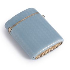 Sotheby's A Gilded Silver and Translucent Blue Guilloche Enamel Vesta Case. Rectangular Form ROunded sides and Hinged Lid with a Cabochon Sapphire Thumb Piece