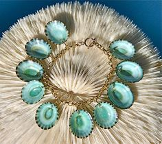Green Limpet Shell Charm Bracelet by Sasha by SashaLickleDesigns, $125.00