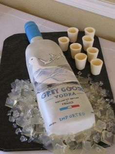 Grey Goose cake with shotglasses and ice