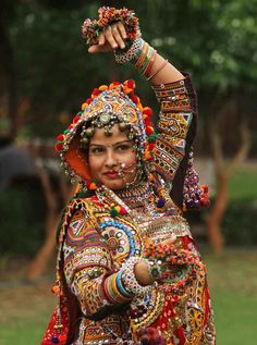 A woman dressed in traditional finery practices the Garba dance, ahead of the Navratri festival in Ahmadabad.