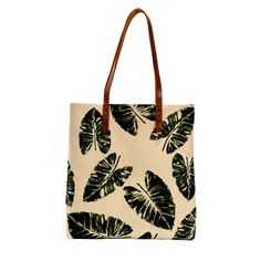 This palm stroke tote from Cord is designed for easy storage of daily essentials. It is constructed in thick cotton canvas with a magnetic closure for easy use and fine leather straps and leather detailing on the reverse. Available at indelust.com