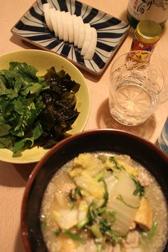 dinner on Fri. 13 Feb. 2015: miso & milk stew with pork, Chinese cabbage, Japanese leek, dropworta Japanese parsley, Aburaagé, Wakame seaweed salad with Mitsuba(Japanese honewort), pickled Daikon, sake, caciocavallo from Hokkaido, then burdock tea