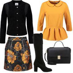Una camicia color oro e una gonna corta con dei fiori dello stesso colore sono le basi di questo abbigliamento. Il giacchino in pelle, corto e con ricami sul giro spalla, è indossato con stivali neri e con una borsa a mano.