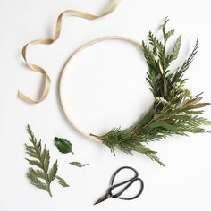 Most simple wreath EVER. I whipped up a few of these beauties in 10 minutes. I'll let you in on my secret: 1. Gather scraps from floral arrangement or tree lot or yard.  2. Bunch scraps together and attach to embroidery hoop using floral wire.  3. Keep adding greenery until just perfect.  4. Hang on wall and admire. 😊 - Sara