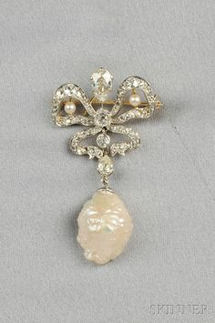 Edwardian Freshwater Pearl and Diamond Pendant/Brooch, set with pear-, old mine-, and rose-cut diamonds suspending a freshwater pearl, platinum-topped 18kt gold mount, lg. 2 in.
