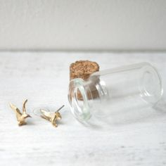 Flying Birds, made of Brass, from Fab.com. Just got these. Love the little bottle, too.