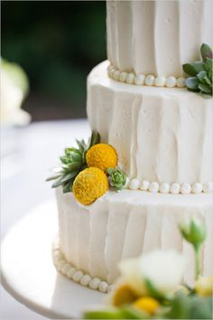 Same cake up close. Love love love. billy button wedding cake. I like the look of the frosting for some reason