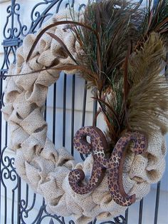 Burlap Bubble Wreath with Feathers. I would replace the monogram letter... With something cooler than a letter.