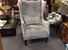 Fabulouse Wingback Chair - A modern take on the traditional wingback chair. A slight mauve tone to the fabric. Very pretty chair.  Item. 762-33.  Price $550.00    - http://takeitorleaveit.co/2015/03/31/fabulouse-wingback-chair/