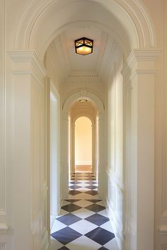 Details...   Arches and trimwork. Dark blue & white harlequin floor is gorgeous.  I would add a spectacular series of sconces along the way
