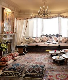 Moroccan Style~ floor pillows, canopy and chandelier, fireplace, oriental rugs…