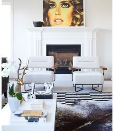 Striped rug with cow hide layered over.... we need this but with the couch and coffee table on other side of room (mirrored)