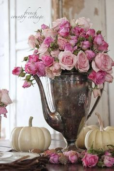 Pink roses in silver pitcher centerpiece