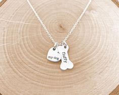 Dog Mom Necklace  Personalized Pet Jewelry is the perfect gift for the dog lover in your life (maybe its you!) and also makes a meaningful gift for pet memorial ♥  Have this necklace engraved with any words and/or names on the heart and bone charms! Choose the number of dog bone charms you need on Dog Necklace, Engraved Necklace, Hearts And Bones, Hand Stamped Jewelry, Meaningful Gifts, Pet Memorials, Animal Jewelry, Dog Mom, Silver