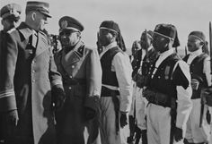 German leader of the Sturmabteilung (SA) Viktor Lutze (left) visits new Italian settlements in Libya. In this picture, Lutze and His Excellency Russo inspect ranks of Askaris (a generic word for 'native soldiers') in Nalut, Libya, February 1939. Previously, in February 1939, Lutze reviewed a parade of 20,000 Blackshirts in Rome before setting off on a tour of Italy's Libyan frontier with Tunisia.