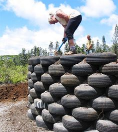 Earthship Homes - Eco-Friendly Use of Tires and Dirt.  Maybe you could use it as a stage for entertainment in your backyard