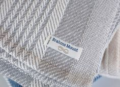 Brahms Mount crafts premium cotton, linen and wool blankets, throws and towels on antique shuttle looms in Maine, USA