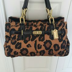 Authentic Coach Handbag Leopard Silk short handle beautiful rare coach. Carried less than 5 times. In good condition. Comes with dusk bag. Coach Bags Satchels