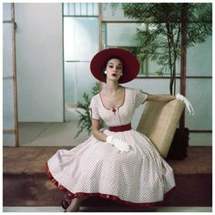 Jean Patchett in red and white polka dot summer dress with petticoat ruffle, hat and gloves NYC 1952 Photo Frances Mclaughlin-Gill