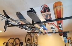 Ski and snowboard rack ceiling rack! #skistorage #snowboardstorage #storeyourboard